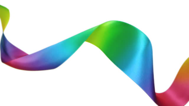 a rainbow colored ribbon on white background, for celebration events and party for new year, birthday party, christmas or any holidays, waiving and curling in super slow motion and close up - lightweight stock videos & royalty-free footage
