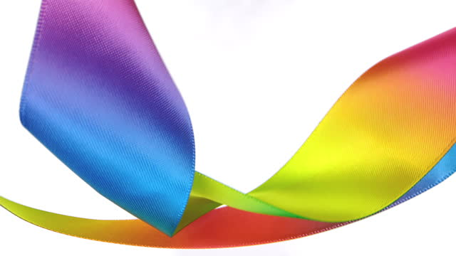 rainbow colored ribbons on white background, for celebration events and party for new year, birthday party, christmas or any holidays, waiving and curling in super slow motion and close up - anniversary stock videos & royalty-free footage