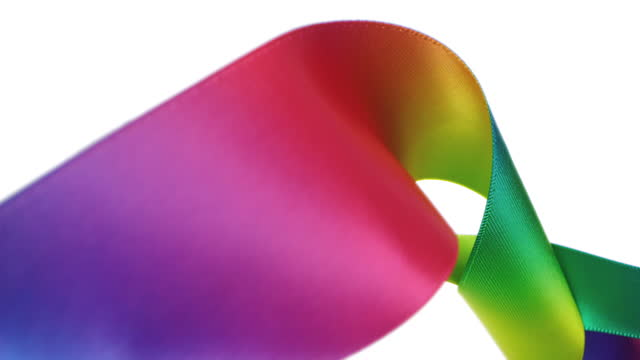 rainbow colored ribbons on white background, for celebration events and party for new year, birthday party, christmas or any holidays, waiving and curling in super slow motion and close up - loopable moving image stock videos & royalty-free footage