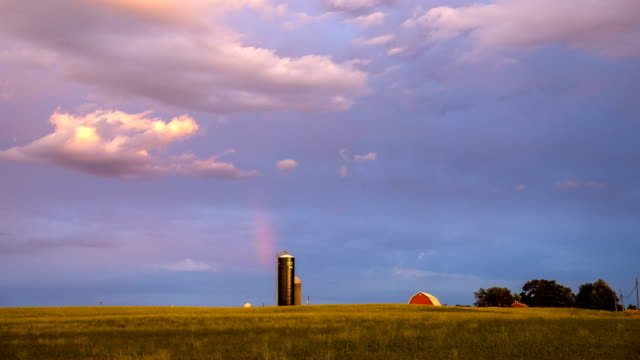 rainbow during sunset in a field - michigan stock videos and b-roll footage