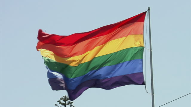 cu rainbow flag against clear sky, san francisco, california, usa - 旗点の映像素材/bロール