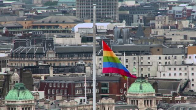 MS TU Rainbow flag being pulled up on mast at St James Park / London, England, United Kingdom