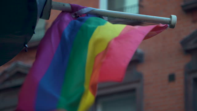 a rainbow flag billows in the wind - rainbow flag stock videos & royalty-free footage