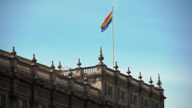 rainbow flag blows above cabinet office, london - identity politics stock videos & royalty-free footage