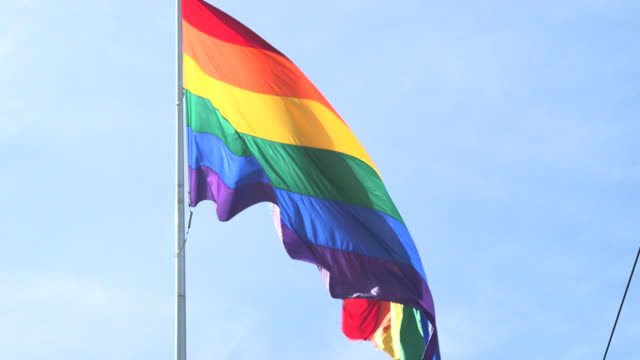 rainbow flag flies in san francisco, tilt up - flag stock videos & royalty-free footage