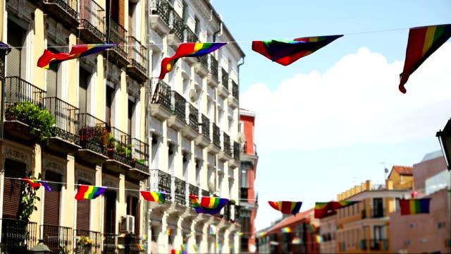 vídeos y material grabado en eventos de stock de bandera del arco iris derechos gay pride en madrid, españa - orgullo