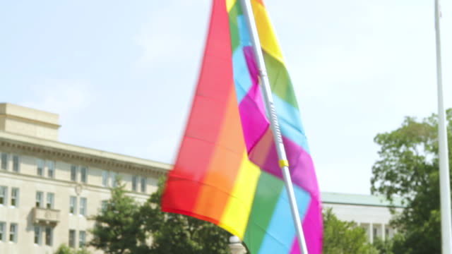 cu rainbow flag is waving in front of supreme court building during rally for marriage equality / washington, district of columbia, united states - rainbow flag stock videos & royalty-free footage