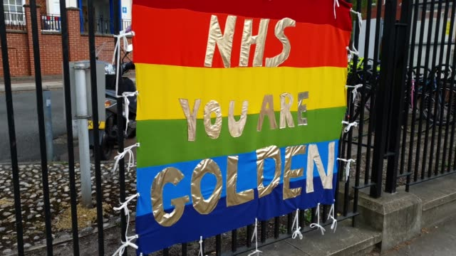 a rainbow flag praises the nhs at kings college hospital denmark hill during the coronavirus pandemic on april 06 2020 in london england there have... - nhs stock-videos und b-roll-filmmaterial