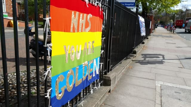 rainbow flag praises the nhs at kings college hospital, denmark hill during the coronavirus pandemic on april 06, 2020 in london, england. there have... - nhs stock videos & royalty-free footage