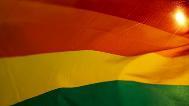 rainbow flag waving in the sunset - flag stock videos & royalty-free footage
