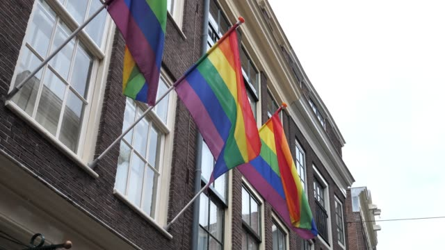 rainbow flags in amsterdam - city of human rights and equality - equality stock videos & royalty-free footage