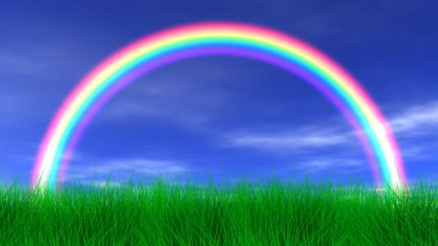 rainbow, grass & peaceful sky - rainbow stock videos & royalty-free footage