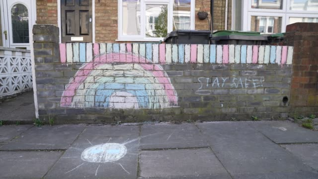 a rainbow has been marked on the wall of a persons house in support the the nhs in london united kingdom during the covid19 coronavirus pandemic - nhs stock videos & royalty-free footage