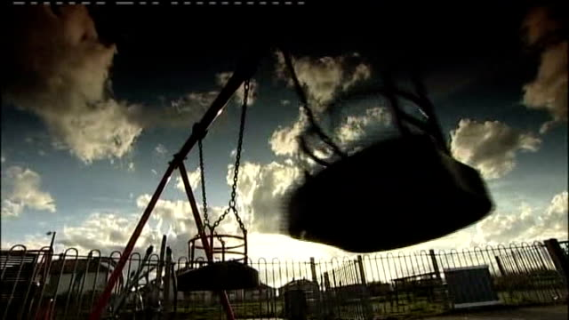 rainbow in grey sky over housing estate close up of swings in playground wasteland on outskirts of doncaster where two young brothers horrifically... - öde landschaft stock-videos und b-roll-filmmaterial