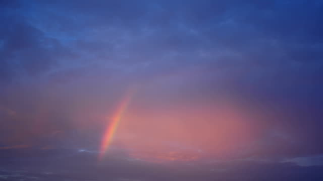 Rainbow in the evening sky time lapse