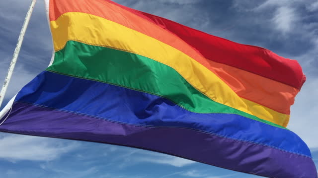 Rainbow LGBT flag waiving in the wind