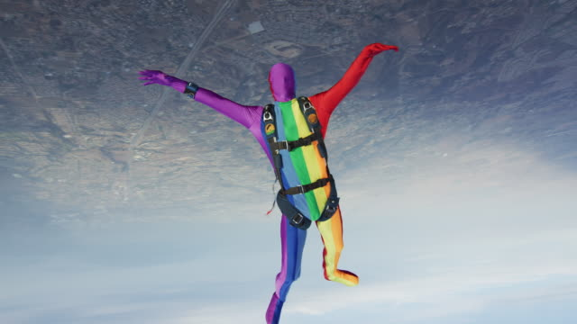 rainbow morph suit skydiver - fancy dress costume stock videos and b-roll footage