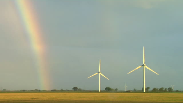 ws rainbow next to wind turbines spinning / goole, north yorkshire, united kingdom - b roll stock videos & royalty-free footage