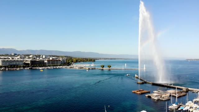 rainbow on jet d'eau fountain in geneva switzerland - sunny drone footage - lake geneva stock videos & royalty-free footage
