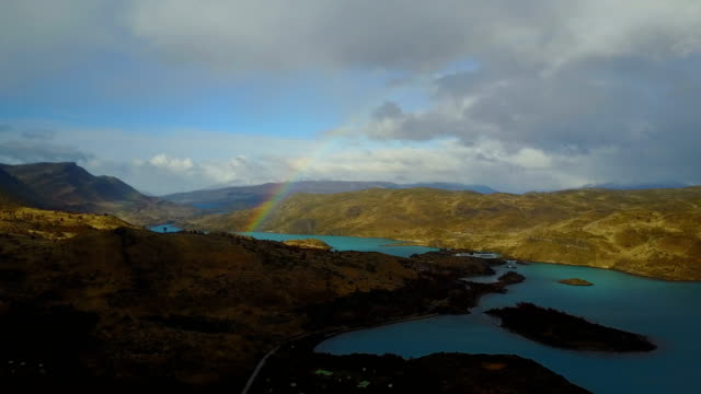 rainbow over lake pehoe and the mountains. torres del paine, patagonia, chile - patagonia chile stock videos and b-roll footage