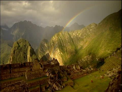 rainbow over macchu picchu ruins peru - machu picchu stock videos and b-roll footage
