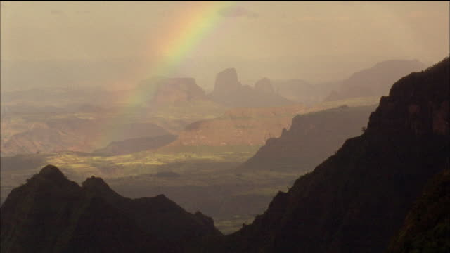rainbow over mountains. available in hd. - horn of africa stock videos and b-roll footage