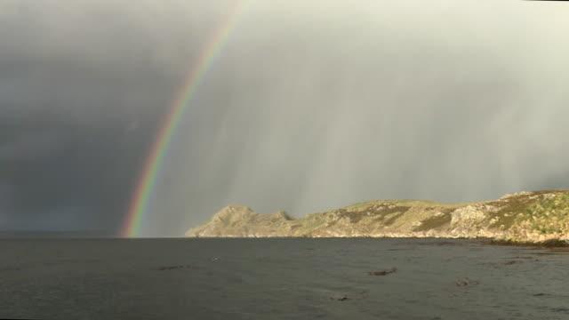 rainbow over sea and barren coast, falkland islands - atlantik stock-videos und b-roll-filmmaterial