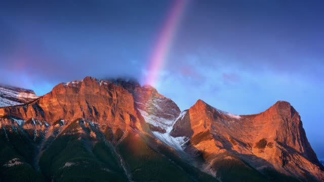t/l rainbow over the canadian rockies at sunrise - spectrum stock videos & royalty-free footage