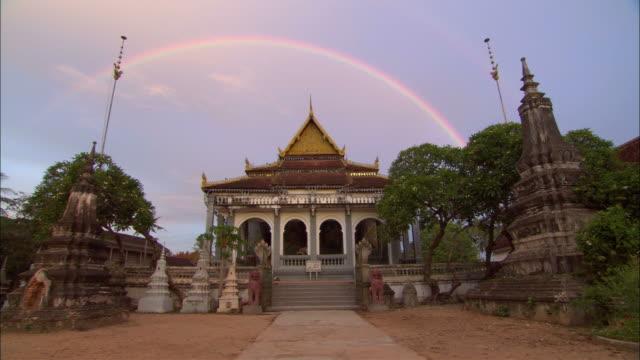 ws, rainbow over theravada buddhist monastery, siem reap, cambodia - theravada stock videos & royalty-free footage