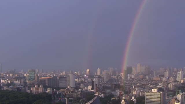 rainbow over tokyo skyline - tilt down stock videos & royalty-free footage