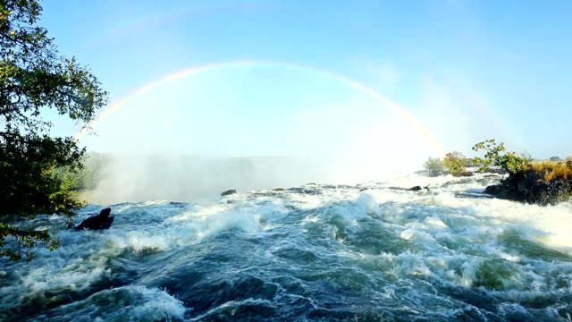 rainbow over victoria falls - victoria falls stock videos and b-roll footage
