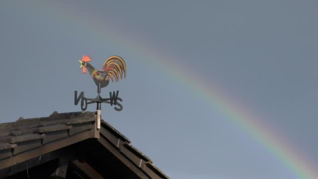 Rainbow over weather vane