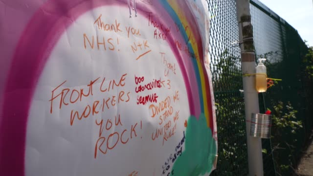 rainbow poster is set up for members of the public to write personal messages for the nhs on it, in london, united kingdom during the covid-19... - rainbow stock videos & royalty-free footage