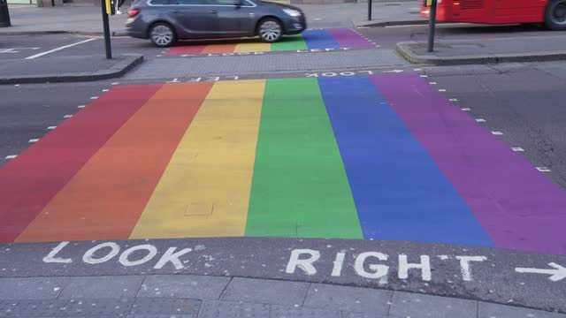 rainbow road crossing in wood green, enfield to show their support to pride in london by painting a zebra crossing in the rainbow flag colours, in... - horse family stock videos & royalty-free footage