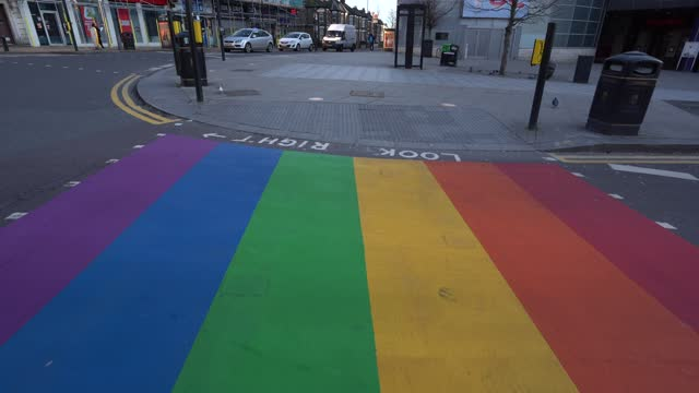 rainbow road crossing in wood green, enfield to show their support to pride in london by painting a zebra crossing in the rainbow flag colours, in... - gender stereotypes stock videos & royalty-free footage