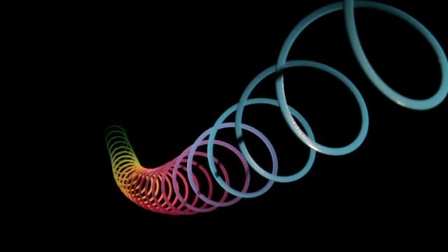arcobaleno lucentezza echo azione riverbero ridotto e ad angolo retto - spirale ricciolo video stock e b–roll