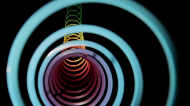 rainbow slinky tunnel twang - coiled spring stock videos and b-roll footage