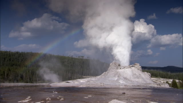 rainbow spectrum formed by erupting castle geyser, yellowstone, usa - boiling stock videos & royalty-free footage