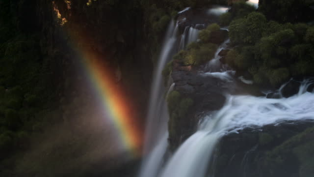 tl rainbow spectrum over misty iguazu falls - idyllic video stock e b–roll