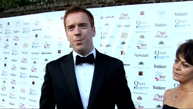 rainbow trust and samuel l. jackson foundation gala; damien lewis and helen mccrory posing for photocall damien lewis interview sot - on having mixed... - ヘレン マックローリー点の映像素材/bロール
