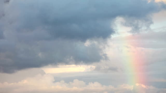 rainbow with storm clouds - rainbow stock videos & royalty-free footage