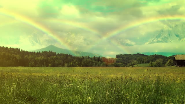 rainbows over the meadow - rainbow stock videos & royalty-free footage
