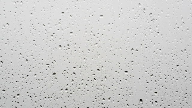 raindrops falling down a window - condensation stock videos and b-roll footage