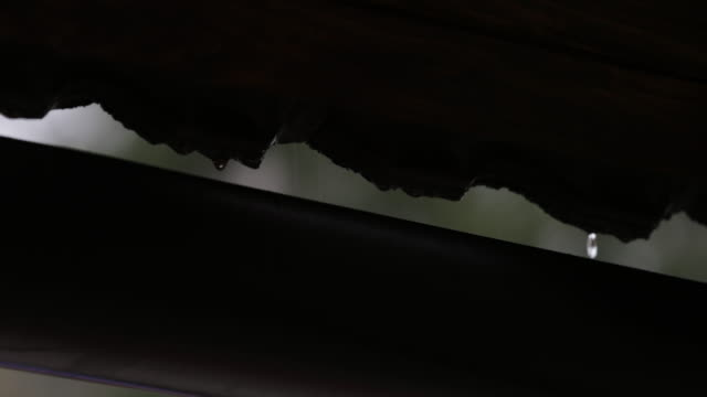 raindrops falling from roof - gutter stock videos and b-roll footage