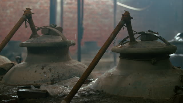 raindrops falling on copper pots / kannauj, uttar pradesh, india - leaking stock videos & royalty-free footage