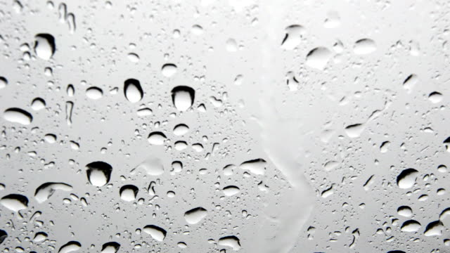 raindrops on car windshield - windshield stock videos & royalty-free footage