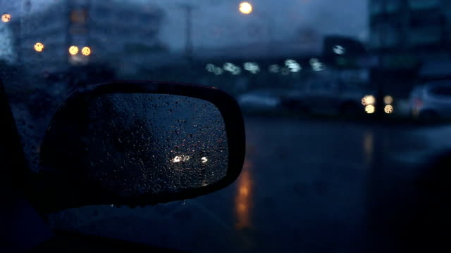 raindrops on mirror car - saving up for a rainy day stock videos and b-roll footage