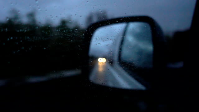 slo mo raindrops on the side mirrors of the car at night - side view stock videos & royalty-free footage