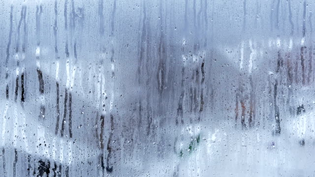 raindrops on window. time lapse. - frost stock videos & royalty-free footage