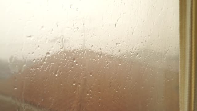 raindrops on windowpane - yuko yamada stock videos & royalty-free footage
